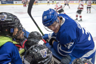 Colin Greening speaks with minor hockey players before a Marlies game
