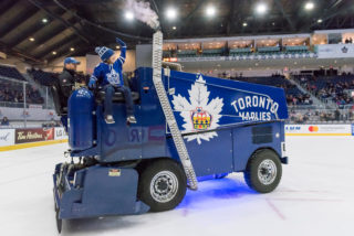 Minor hockey player rides the zamboni during a Marlies game