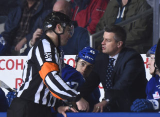 Coach Sheldon Keefe talks with referee