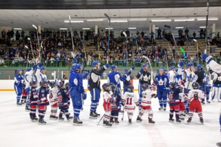 Marlies players salute the crowd at a community festival